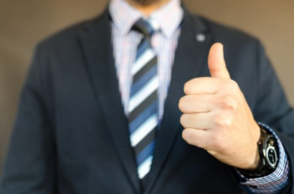 businessman in suit thumbs up