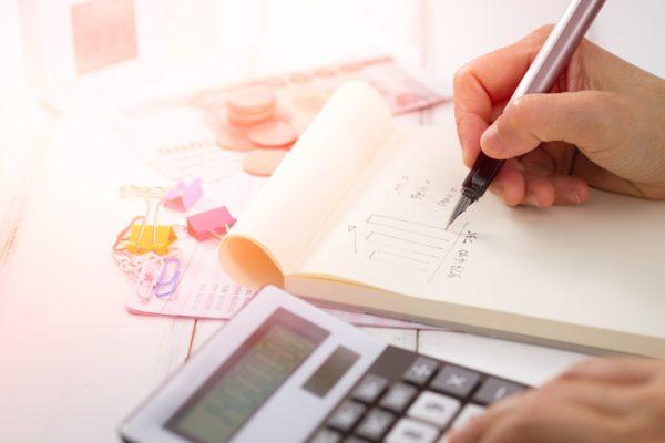 financial paperwork and calculator